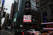 Painter Denis De Gloire on the world's largest billboard of Times Square, NY