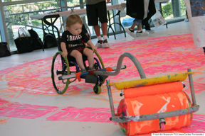 Artist Shirks Fame To Invent Tools That Allow Kids With Disabilities To Paint